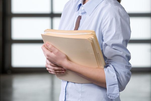 woman-holding-folders