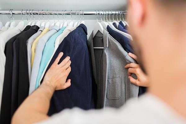 man-looking-through-closet