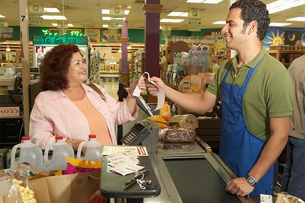 customer-smiling-at-cashier