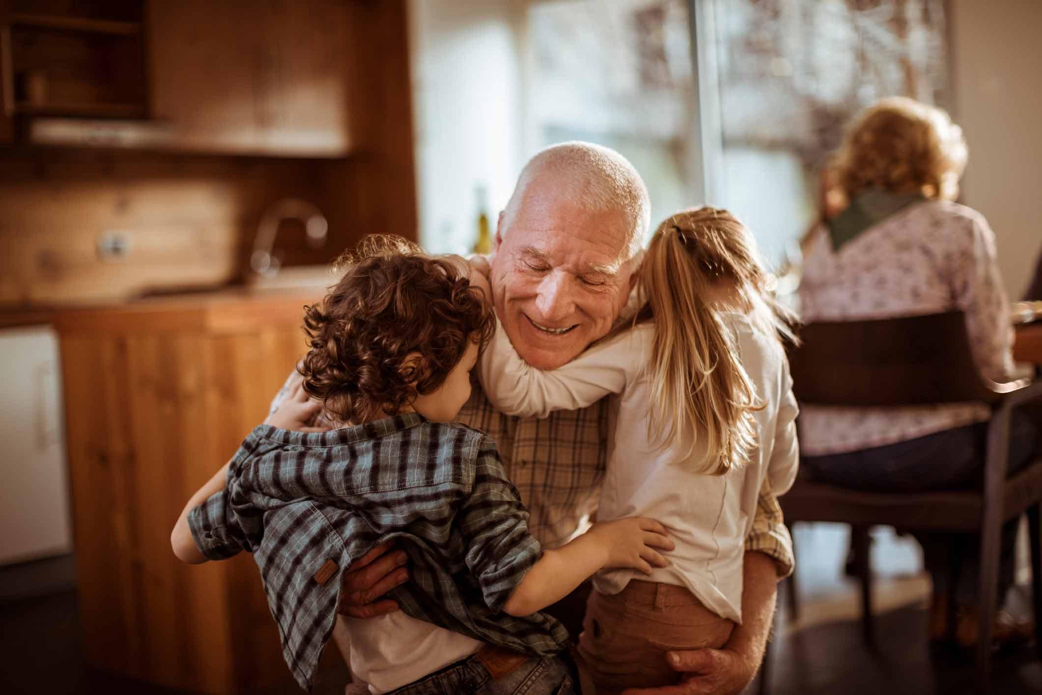 Grandpa hugging grandkids