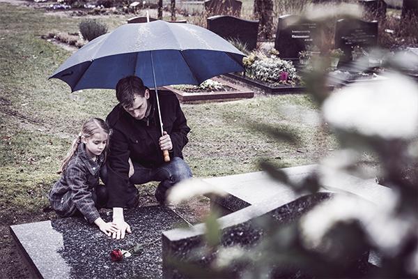 children-visiting-parents-grave