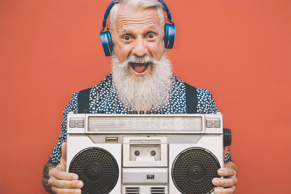 older man listening to music boombox