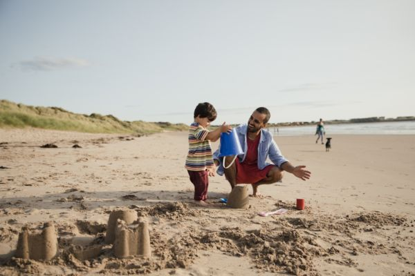 father-son-building-sand-castle