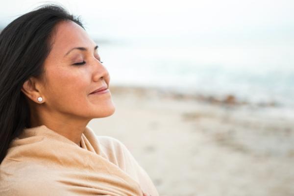 woman-smelling-ocean-breeze