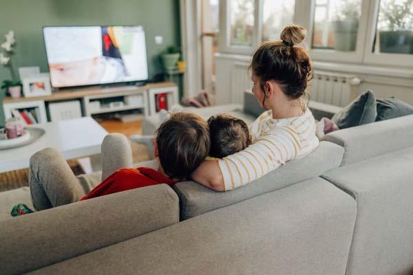 mom and kids watching tv