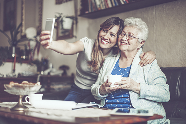 Girl taking photo with grandma