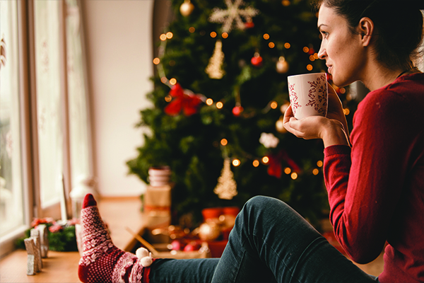 girl-sitting-in-front-of-holiday-tree