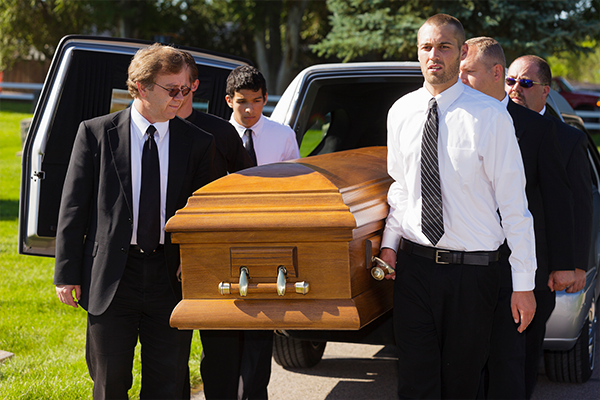 men-carrying-casket