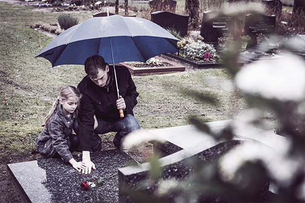 children-visiting-parents-grave
