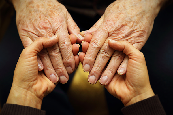 holding-grandparents-hands